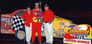 Carl Myers (R) pictured with wife Ann and Vic Coffey in Victory Lane